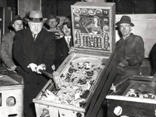 Lawmen take out their regressed 1950s sexual frustration on pinball machines. | Str N Gaming